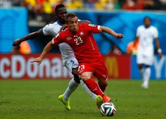 Xherdan Shaqiri of Switzerland controls the ball as Maynor Figueroa of Honduras gives chase during the 2014 FIFA World Cup Brazil Group E match between Honduras and Switzerland at Arena Amazonia on June 25, 2014 in Manaus, Brazil.