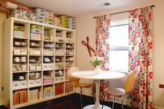 The PinkLovesBrown design studio is inspiring with its tall, color-coordinated shelves keeping everything organized and easily accessible. (http://www.flickr.com/photos/pinklovesbrown/2979608898/in/pool-handmadespaces)
