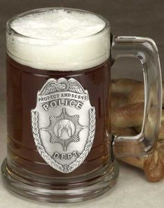 http://www.firecatalog.com/product/Police-Badge-Tankard/Police_Sheriff_Mugs_Glassware