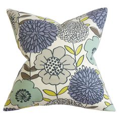 A lovely touch for your sofa, bed, or chaise, this cotton pillow showcases a down insert and a vibrant floral motif.     Product: