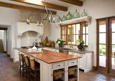 Mediterranean kitchen design ideas white cabinets solid wood countertop kitchen island with seating exposed ceiling beams