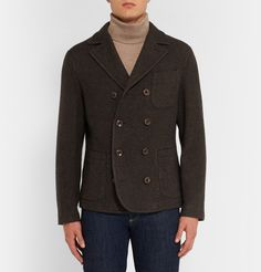 Italian tailoring house Boglioli is renowned for beautifully made unstructured jackets. Handcrafted from textured wool-blend, this double-breasted piece is inspired by classic newsboy styles and cut in a trim fit that makes it both insulating and smart. Dropped shoulders and deep patch pockets emphasise its relaxed yet rugged appeal. Style yours with cuffed jeans and utilitarian boots. Shown here with a Paul Smith scarf, Gieves & Hawkes rollneck and Brunello Cucinelli jeans and boots.