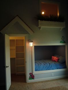 "Bed nook and a door to the closet which holds a ladder to a reading space with the ""balcony"" window above the bed to look out."