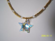 Swarovski Star with Gold Seed Bead by lindasoriginaljewels on Etsy, $20.00