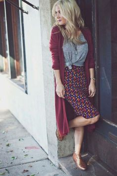 Street style | Burgundy vest over grey tshirt and patterned skirt