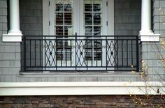 front porch with wrought iron railings - railing inspiration