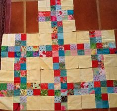Aha!! Not how I would have achieved this look, but so much simpler! A nine-patch made with 5 FOUR-patches!  Charlotte's Cottage