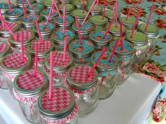 Cupcake liner mason jar lids. I did this for my wedding reception. I took blue puff paint and wrote our wedding date on one side and Our initials on the other and it was also a party favor....BIG hit!