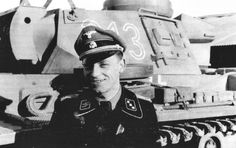 A SS Panzer commander poses for the camera next to his Panzer IV. The special Black Panzer uniform for tank and armoured crews was developed from the existing Army equivalent. The uniform in this photograph is that of an SS-Untersturmführer of the Leibstandarte Division.