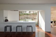 This contemporary house is like a grand porch, where the courtyards modulate the atmospheric conditions and the privacy between the inside and the outside.