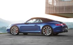 2013-Porsche-911-Carrera-4S-Cabriolet-blue-left-side-top-up.jpg 1,500×938 pixels