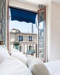 Eiffel Tower view from the bedroom of the Cassis apartment rental | Paris Perfect