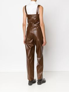 Brown wool blend faux leather dungarees from KOONHOR featuring adjustable straps, belted, front zipped pockets, side pockets, rear pockets and a wide leg.   Item ID: 11146959
