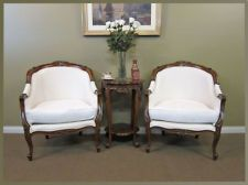A PAIR OF FRENCH STYLED LOUIS TUB CHAIRS UPHOLSTERED IN CALICO