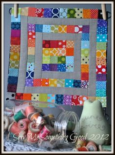 scrap quilt. I like the gray sashing, as opposed to white.