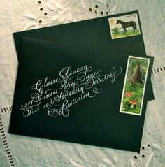 Love the slant and the white ink, not to mention the vintage stamps!