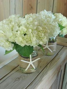 Beach wedding centerpieces    This would be cute on larger tables with a few bright pink daisies popping out! -d