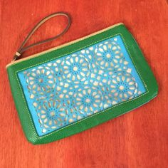 Laser Cut Loft Clutch Brand new, never used green and aqua colored clutch from loft. Features a gorgeous laser cut floral design, a zippered top and a small handle/strap. New without tags. Please ask if you have any questions, need any measurements or more pictures. LOFT Bags Clutches & Wristlets