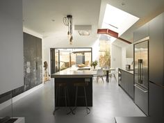 Our Raine kitchen is both impressive and robust with a semi industrial look and exposed steel beams designed to withstand the daily demands of family life.