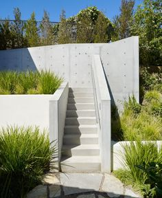 Great concrete stairs and retaining walls.    Treehouse getaway nestled in a sweeping canyon.    Part office/studio, part recreational getaway, this unique project designed by Rockefeller Partners Architects is situated at the base of a large pine tree in the backyard of a residence in Los Angeles, California.