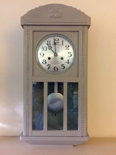 1930s wall regulator clock. Annie Sloan Chalk Paint - Paris Grey mixed with a little French Linen (exterior) and Duck Egg (interior and rim of clock face). Silver paste used on the pendulum and to highlight the top moulding and side beadings.