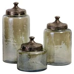 i love glass jars/canisters with metal lids.  The tint and texture on this glass here is very intriguing...