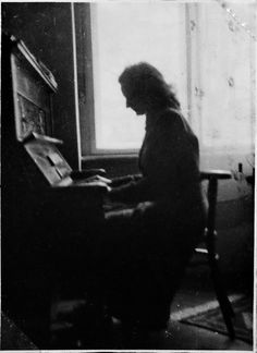 """1942  Babci playing the pianino.  Probably on a visit at uncle's in Beregszász.  She was a musician.  This is a very tiny photo."""