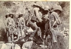 British troops bringing down a wounded colleague Tirah Expedition 1898