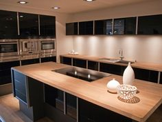 Image result for oak counter top with stainless