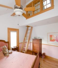 A ladder gives access to a small loft that hangs over this bedroom.