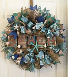 Beach Wedding,Beach Wreath,Beach House, Nautical Wreath,Nautical Wedding,Wedding Decor,Wedding Gift  Great addition to your nautical decor, bring a part of the beach closer to you with this Beach Wreath!  Also the perfect wedding gift for that Bride and Groom that love the beach!  I can also make 2 for your Double Front Door!  This fun beach filled Nautical Wreath was made with burlap, turquoise burlap wired ribbon, burlap with white edges wired ribbon, stripped teal & white wired ribbon,...