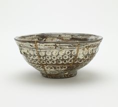 Joseon period, 15th century Korea Stoneware with white inlay under transparent glaze; gold lacquer repairs 5.9 x 13.2 cm