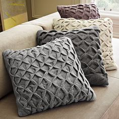 Sculpted Origami Pillow Cover...i can knit this