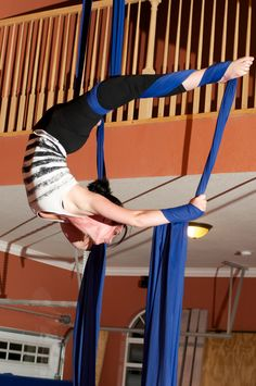 Taira pulling an aerial back bend at Circus-Arts on the silks.