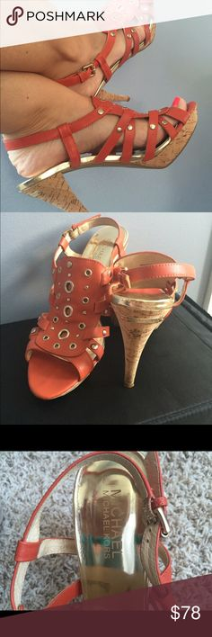 """Michael Kors sandals Michael Kors sandals, size 9M. Orange leather upper with stud and grommet details. Cork heels and platform. Adjustable buckle. Heel measures 4"""" and platform 1"""". Perfect condition! Only worn 3 times with only evidence of wear on bottom. Michael Kors Shoes Sandals"""