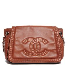 This is an authentic CHANEL Calfskin Coco Bengal Accordion Flap in Camel.  This chic shoulder bag is crafted of luxurious calfskin leather in brown.  The bag features a bold embossed border trim and a bold embossed Chanel CC logo.  The bag features silver chain link shoulder straps threaded with leather, a rear flap, and the full frontal flap opens to a fabric interior spacious enough for all of your everyday necessities with the timeless style only from Chanel!