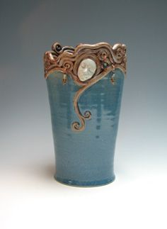 Theresa Glisson, Coiled Vase :: This piece was wheel thrown. The coils were added on the top edge. The face was sculpted and added. The beads were added after the firing. Cone 10 stoneware . Reduction fired.