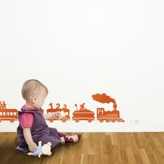I'm pretty sure the graphics for this design are based on the Fisher Price Circus train I had circa 1978... loved that toy, like these stickers. http://www.thisoldtoy.com/new-images/images-ok/900-999/fp991-circus-train.jpg