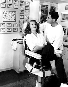 Rita Hayworth in Clay Campbell 's makeup chair during the filming of Gilda, 1946