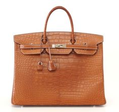 29f6ba78f32e Guaranteed authentic HERMES 40 Birkin in coveted FAUVE Alligator with bone  top stitch detail is the