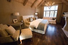 dark floors; linen bedding;chair fabric, beams  Love this room...