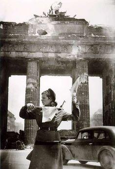 Russian soldier directs traffic at the Brandenburg Gate. Berlin, 1945. Boris Puschkin