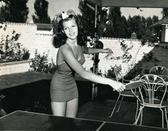 Rita Hayworth playing ping pong.