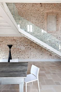 Floor and stone walls exposed. Modern-Rustic Trend - Beautiful old stone home with beautiful natural stone flooring. Similar Limestone tiles can be sourced from Mandarin Stone. www.mandarinstone.com.