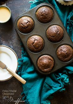 Maple Tahini Chocolate Paleo Muffins - These gluten free chocolate muffins are sweetened with maple syrup and have a hint of tahini. They're a healthy, easy breakfast for busy mornings that are only 170 calories! | Foodfaithfitness.com | @FoodFaithFit