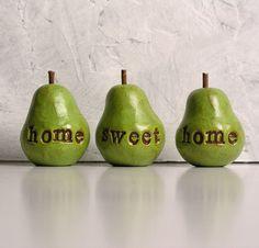 three handmade decorative polymer clay pears