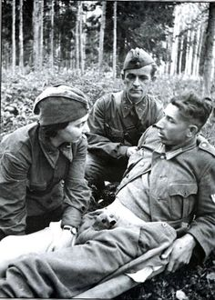 A German POW being treated by a Soviet medic. I would guess this is a propaganda photograph because why else would the Red Army waste supplies on the enemy?