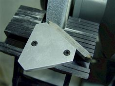 Top & Bottom View Of A Jig Used To Grindtool Bits For Threading It Is