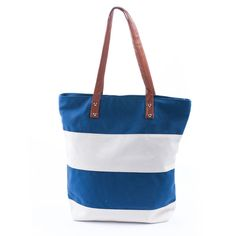 A blue and white striped canvas beach bag tote shopper thick canvas fabric and faux leather handles The bag fastens with a zip to the top