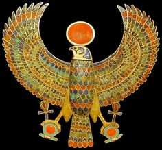 Gold falcon with semiprecious stones and light blue glass. TUTANKHAMUN the most famous Egyptian pharaoh